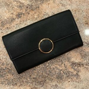 Handbags - Black and Gold Clutch❗️Like New❗️Strap Included❗️